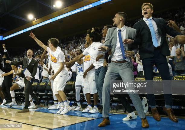 Members of the UCLA Bruins basket ball team celebrate at the bench area after a threepoint shot was made by Kris Wilkes of the UCLA Bruins for the...
