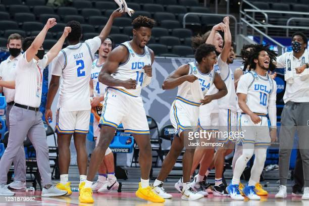 Members of the UCLA Bruins celebrate a win against the Abilene Christian Wildcats in the second round of the 2021 NCAA Division I Mens Basketball...