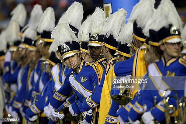 Members of the UCLA Bruins marching band wait to perform before the game with the Houston Cougars at the Rose Bowl on September 18 2010 in Pasadena...