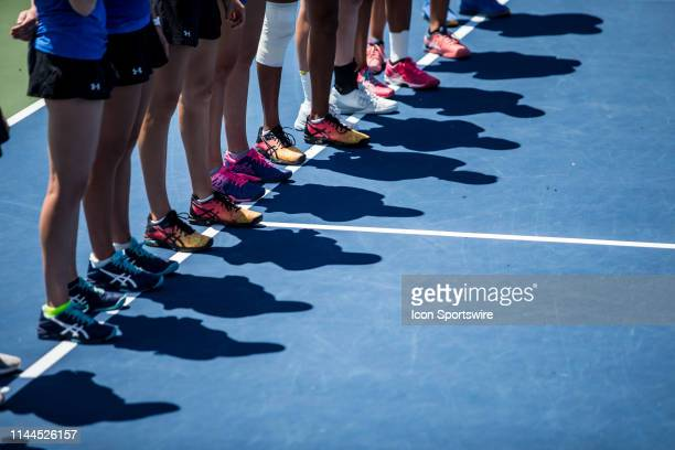 Members of the UCLA women's tennis team line up for the national anthem before the quarterfinal round of the NCAA Division I Women's Tennis National...