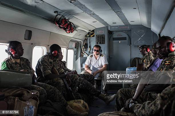 Members of the Uganda People's Defense Force serving in the African Union Mission in Somalia travel in an United Nations helicopter on October 10...