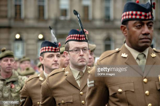 Members of the UK Armed Forces during a parade in George Square Glasgow Members of the UK armed forces Police Scotland Public and other services paid...