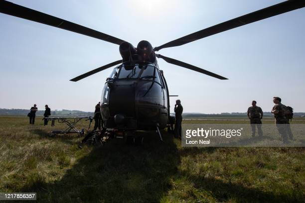 Members of the UK Armed Forces work with NHS medical staff and Air Ambulance Service crews onboard a Puma HC2 helicopter at Thruxton Aerodrome on...