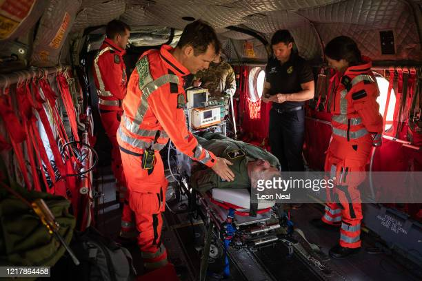 Members of the UK Armed Forces work with NHS medical staff and Air Ambulance Service crews onboard a Boeing CH47 Chinook helicopter at Thruxton...