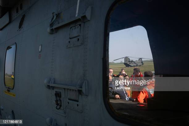 Members of the UK Armed Forces work with NHS medical staff and Air Ambulance Service crews on a AgustaWestland AW101 Merlin helicopter at Thruxton...