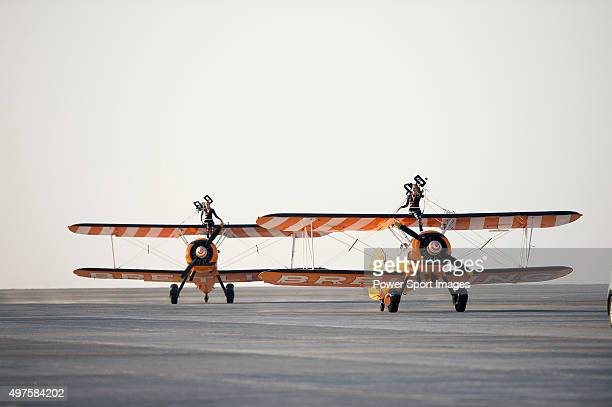 Members of the UK based Breitling Wingwalkers team perform aerial aerobatic formations with their Boeing Stearman biplanes during the Dubai Airshow...