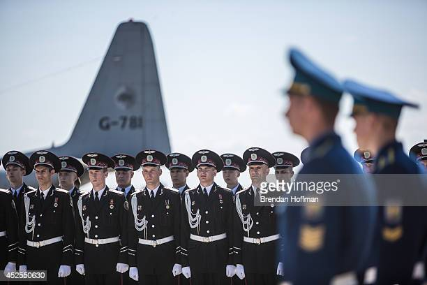 Members of the Ukrainian military stand to attention as coffins containing the bodies of victims of the crash of Malaysia Airlines flight MH17 are...