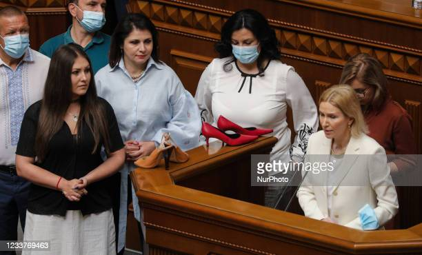 Members of the Ukrainian Parliament brought high-heeled shoes to the rostrum of the Verkhovna Rada during the session to protest and demand that the...