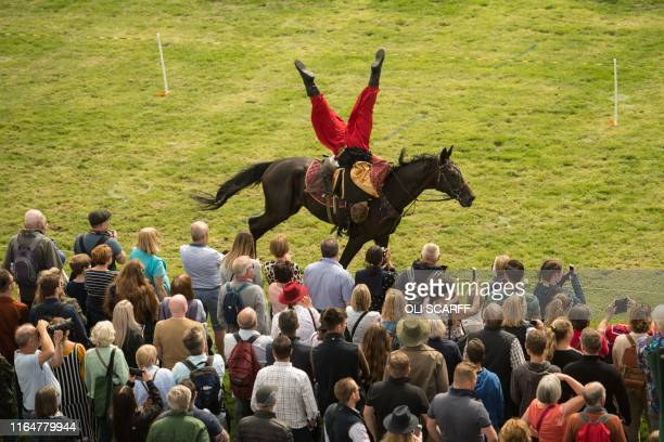 Members of the Ukranian Cossack Stunt Team perform in the Grand Ring on the first day of the Chatsworth Country Fair in the grounds of Chatsworth...