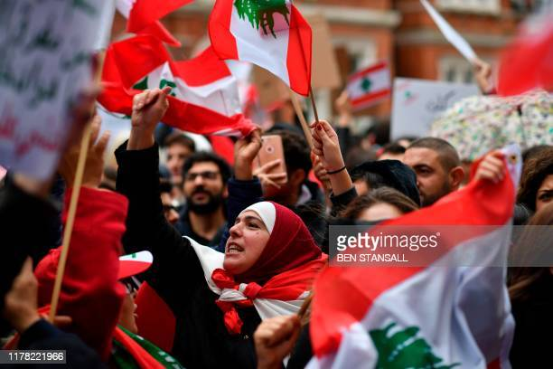 Members of the UK's Lebanese diaspora community and supporters protest in solidarity with ongoing demonstrations in Lebanon calling for political...