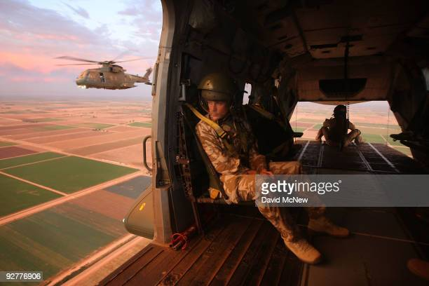 Members of the UK's Royal Air Force fly over farmlands as they return to base after practicing lowvisibility dust landing in an ancient sea bed that...