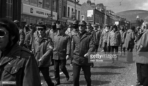 Members of the Ulster Defence Association a loyalist paramilitary organisation march along the Shankill Road Belfast 14 October 1972