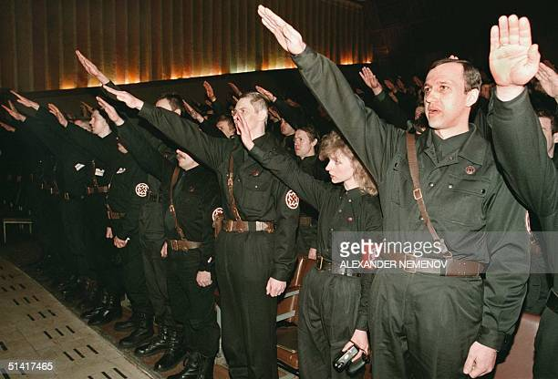 Members of the ultranational organization Russian National Unity give the Nazi salute and shout Vivat Russia during the opening ceremony of their...