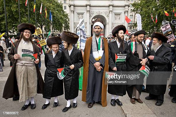 CONTENT] Members of the UltraOrthodox Jewish community standing together with a Shia and a Sunni Muslim cleric at the annual proPalestine march
