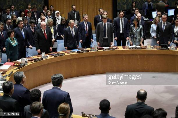 Members of the UN Security Council stand for a moment of silence for the victims of the recent mass shooting in Florida before the start of a United...