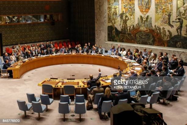 TOPSHOT Members of the UN Security Council vote at a UN Security Council meeting over North Korea's new sanctions on September 11 2017 at the UN...