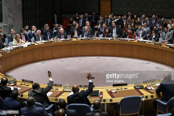 Members of the UN Security Council vote on a US draft resolution to create a new inquiry to find blame for the chemical weapons attack last week in...