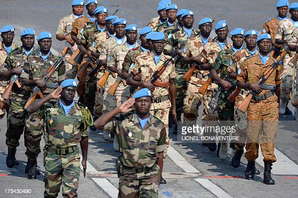 Members of the UN stabilisation force to Mali march during the Bastille Day parade on the Champs Elysees avenue, on July 14, 2013 in Paris. AFP PHOTO...