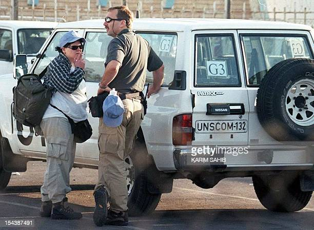 Members of the UN weapons inspections team in Baghdad prepare to leave headquarters for their daily work 10 December one day after Iraq turned away...