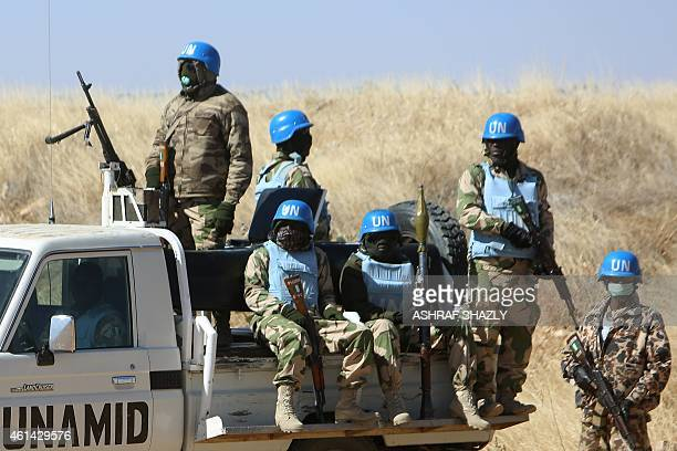 Members of the UNAfrican Union mission in Darfur patrol the area near the city of Nyala in Sudan's Darfur on January 12 2015 Qatar's deputy premier...