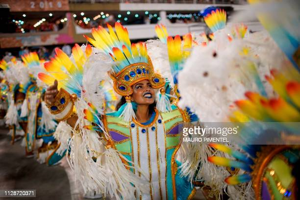 Members of the Uniao da Ilha samba school perform during the second night of Rio's Carnival parade at the Sambadrome in Rio de Janeiro Brazil early...