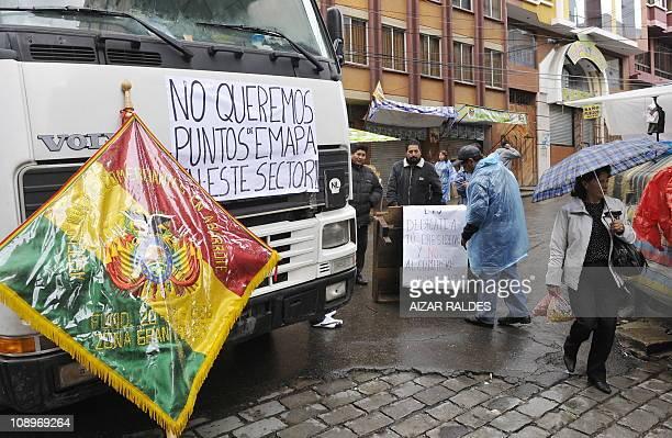 Members of the union of retail sales vendors block streets to protest against the state company Empresa de Apoyo a la Producción de Alimentos in La...