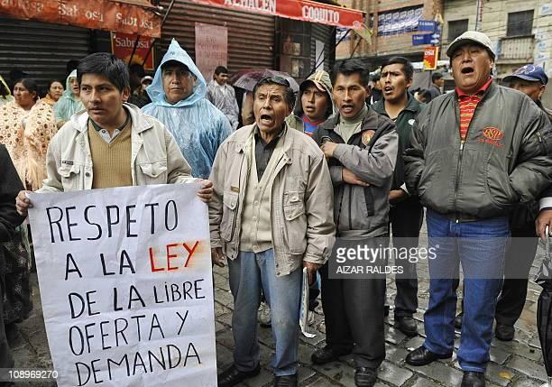 Members of the union of retail sales vendors protest against the state company Empresa de Apoyo a la Producción de Alimentos in La Paz on February 10...
