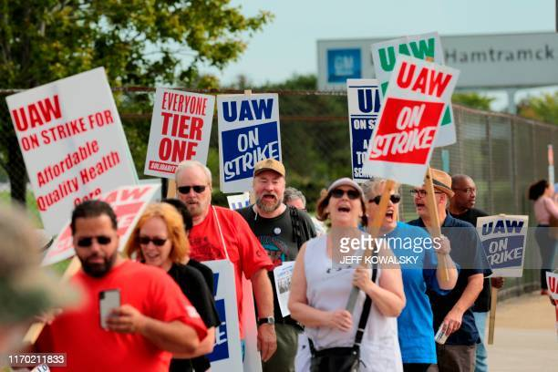 Members of the United Auto Workers and supporters picket outside of General Motors DetroitHamtramck Assembly in Detroit Michigan as they strike on...