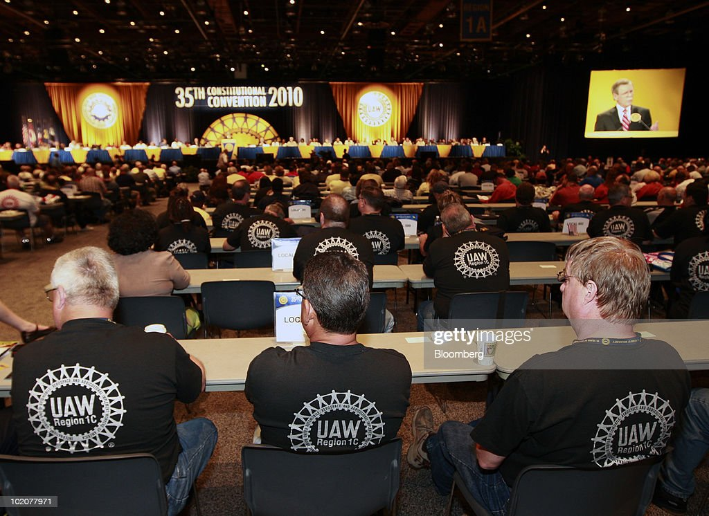 Members of the United Auto Workers listen to Ron Gettelfinger, outgoing president of the United Auto Workers, speak at the UAW's constitutional convention in Detroit, Michigan, U.S., on Monday, June 14, 2010. Gettelfinger, ending eight years as the union's leader, said the U.S. auto industry is recovering and credited President Barack Obama with saving it. Photographer: Jeff Kowalsky/Bloomberg via Getty Images