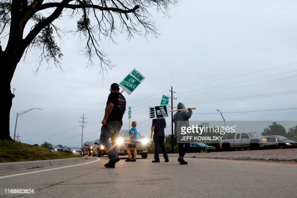 TOPSHOT Members of the United Auto Workers who are employed at the General Motors Co Flint Assembly plant in Flint Michigan slow down salary...
