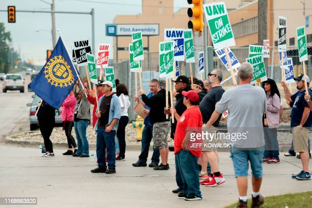Members of the United Auto Workers who are employed at the General Motors Co Flint Assembly plant in Flint Michigan picket outside of the plant as...