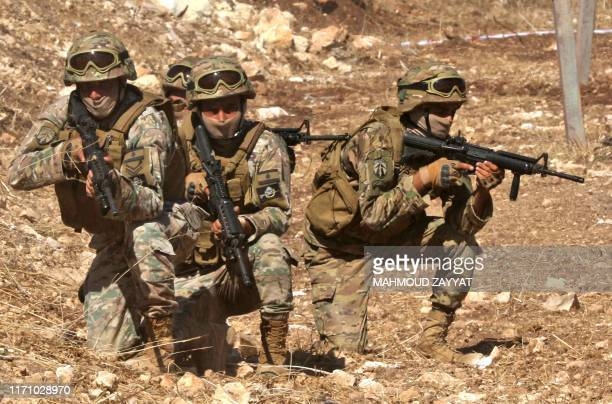 Members of the United Nations Interim Force in Lebanon and soldiers from the Lebanese Armed Forces take part in a live fire exercise south of UNIFIL...