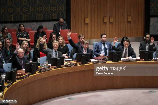 Members of the United Nations Security Council vote on a North Korea resolution March 21 2018 in New York City The Security Council voted unanimously...