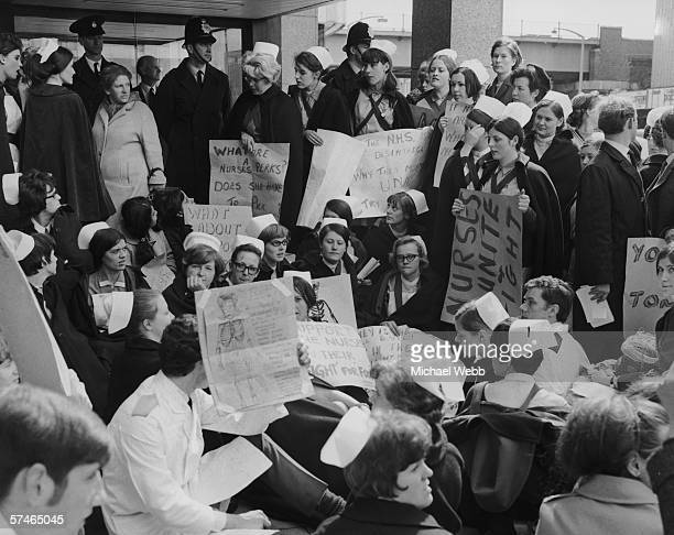Members of the United Nurses Association stage a sitdown protest against their pay and conditions outside the London headquarters of the Department...