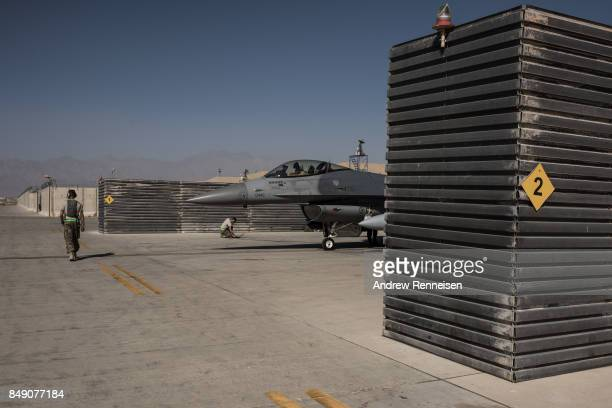 Members of the United States Air Force deployed for Mission Resolute Support prepare an F16 Jet for a flight at Bagram Air Field on September 5 2017...