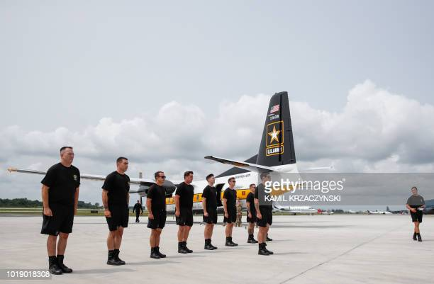 Members of the United States Army Parachute Team Golden Knights prepare to fly over downtown Chicago during 60th Annual Chicago Air and Water Show on...