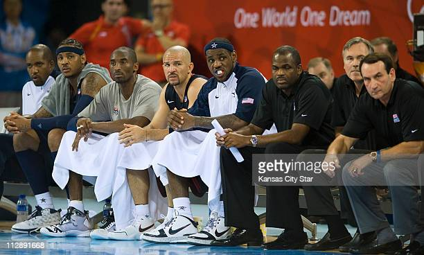 Members of the United States basketball team watch teammates in a closer match than they have had all games as they face Spain in the gold medal game...