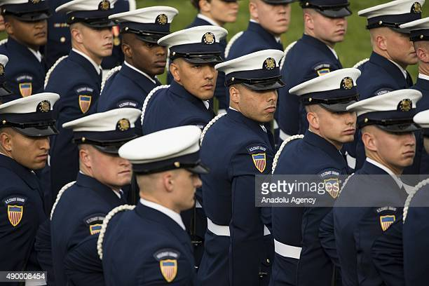 Members of the United States Coast Guard Ceremonial Honor Guard adjust their formation before President Barack Obama welcomes Chinese President Xi...