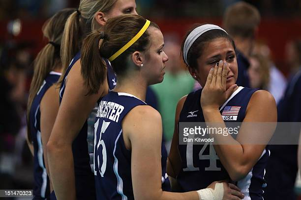 Members of the United States console each other after losing to China at the Women's Sitting Volleyball final Gold Medal match on day 9 of the London...