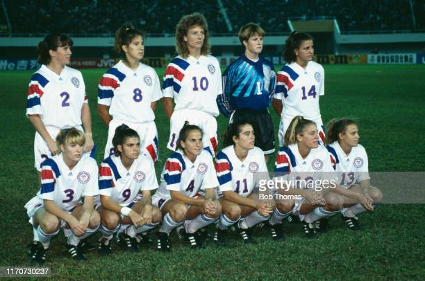 Members of the United States football squad posed together prior to playing in a group B match during the 1991 FIFA Women's World Cup tournament in...