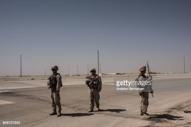 Members of the United States Marine Corp Task Force South West keep watch of a runway on September 10 2017 at Camp Shorab in Helmand Province...