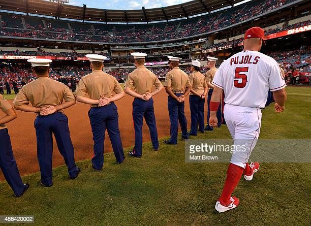 Members of the United States Marine Corps stand at attention waiting for an onfield ceremony remembering victims of 9/11 as Albert Pujols of the Los...