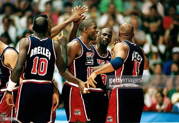Members of the United States Men's National Basketball Team celebrate on the court during the 1992 Summer Olympics in Barcelona Spain NOTE TO USER...