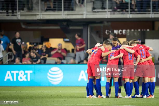 Members of the United States Men's National team huddle with the AT&T logo behind them during the International Friendly match between the USA Men's...