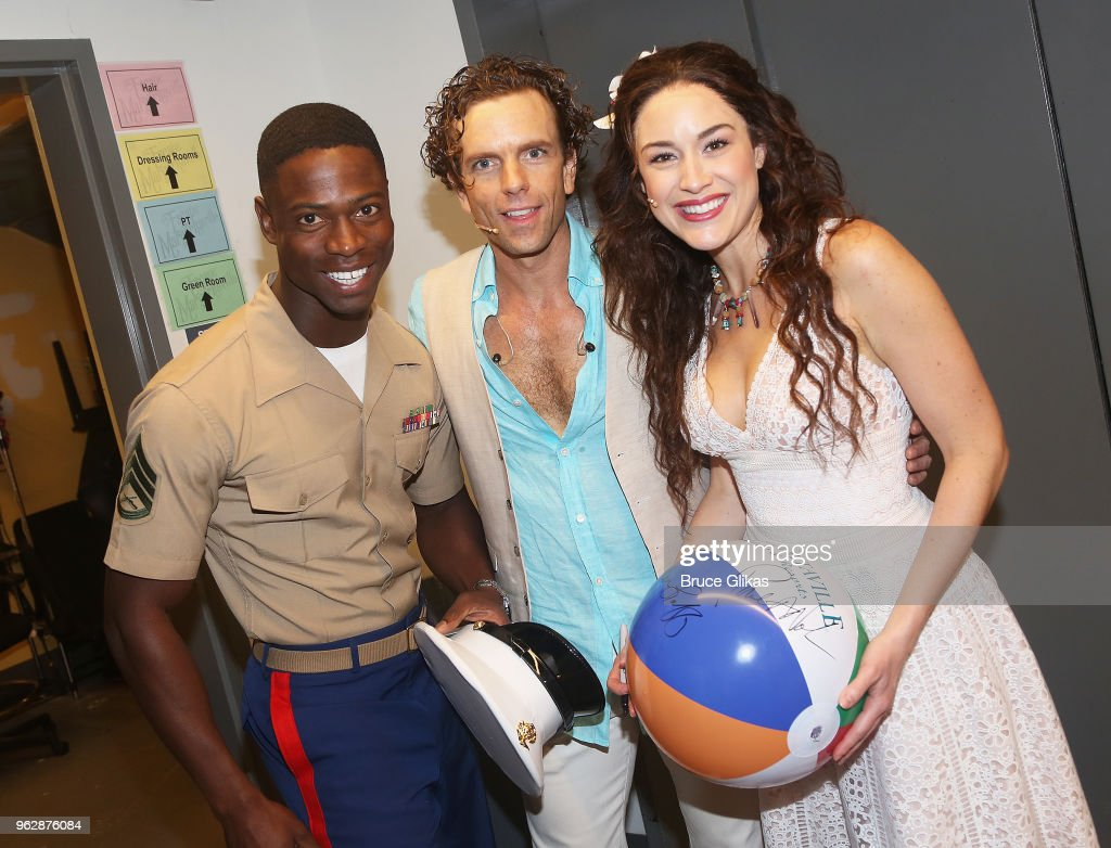 Members of the United States Military pose with Alison Luff and Paul Alexander Nolan of the cast of the Jimmy Buffett Broadway Musical 'Escape to Margaritaville' backstage to celebrate Memorial Day Weekend at The Marquis Theatre on May 26, 2018 in New York City.