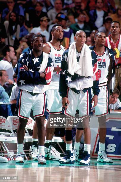 Members of the United States National Team cheer on their teammates against the Australian National Team during the 1996 Summer Olympics played July...