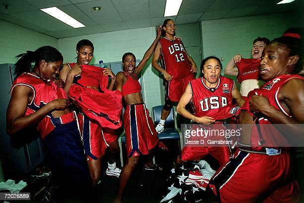 Members of the United States National Team have some fun in the locker room during the 2000 Summer Olympics Gold Medal Ceremony held September 29...