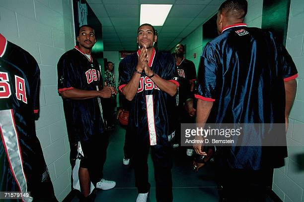 Members of the United States National Team prepare to take the court against the Canadian National Team during a 2000 pre-Olympic exhibition game on...