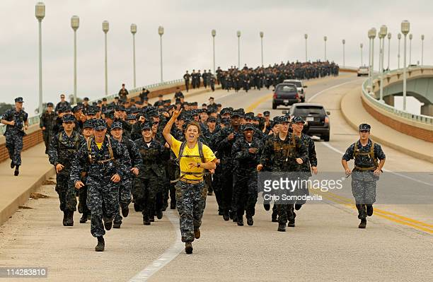 Members of the United States Naval Academy freshman class Company 16 lead a twomile run across the Naval Academy Bridge during the rigorous Sea...