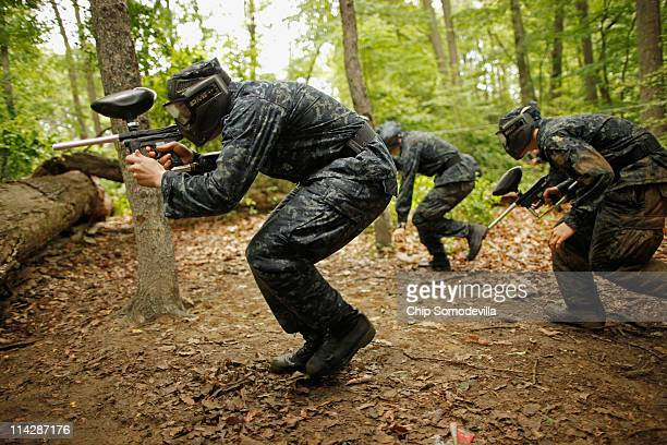 Members of the United States Naval Academy freshman class engage in a paintball battle during the rigorous Sea Trials May 17 2011 in Annapolis...
